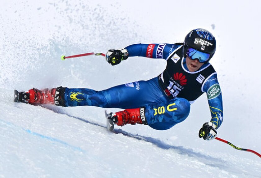 Breezy Johnson of the United States in action during the women's Downhill race at the FIS Alpine Ski World Cup in Crans-Montana, Switzerland, Friday, Jan. 22, 2021. (Jean-Christophe Bott/Keystone via AP)