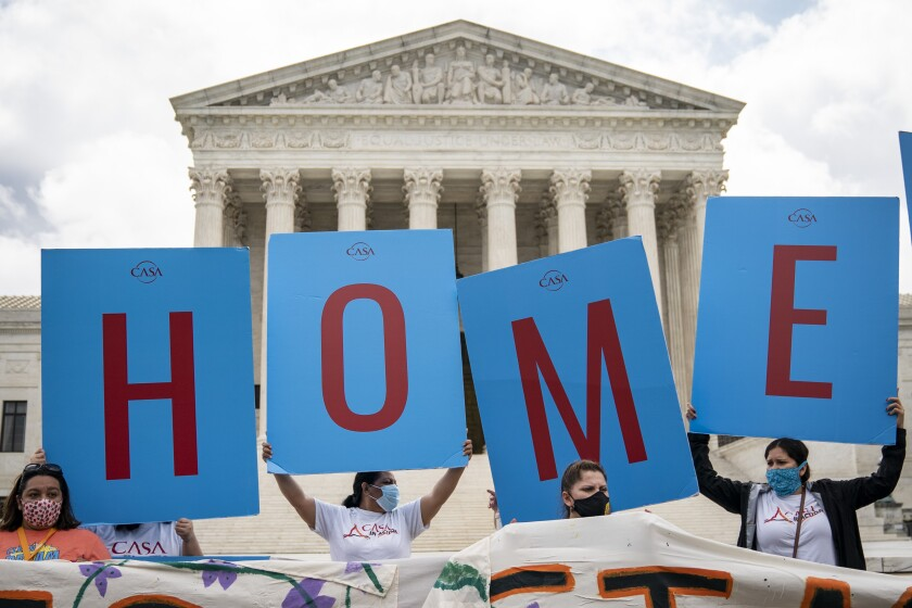 DACA recipients and their supporters rally outside the U.S. Supreme Court on June 18, 2020.