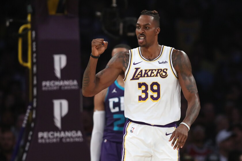 Lakers center Dwight Howard reacts after being fouled during Sunday's win over the Charlotte Hornets.