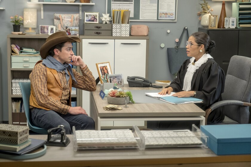 "Ben Feldman and America Ferrera, in costume as Ruth Bader Ginsburg, in ""Superstore"" on NBC.""Superstore"" on NBC."