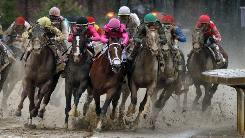 In this Saturday, May 4, 2019, file photo, from left, Country House, ridden by Flavien Prat, War of