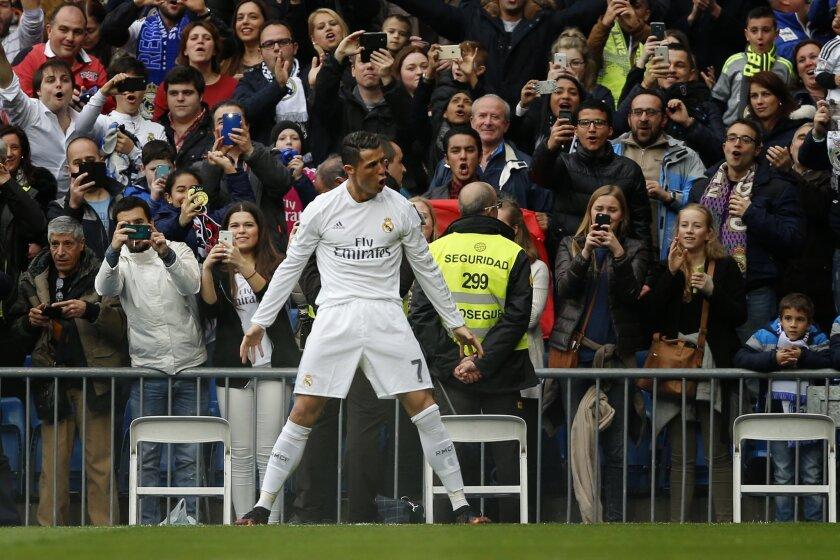 Real Madrid's Cristiano Ronaldo celebrates after scoring a goal during a Spanish La Liga soccer match between Real Madrid and Athtletic Bilbao at the Santiago Bernabeu stadium in Madrid, Spain, Saturday, Feb. 13, 2016. (AP Photo/Daniel Ochoa de Olza)