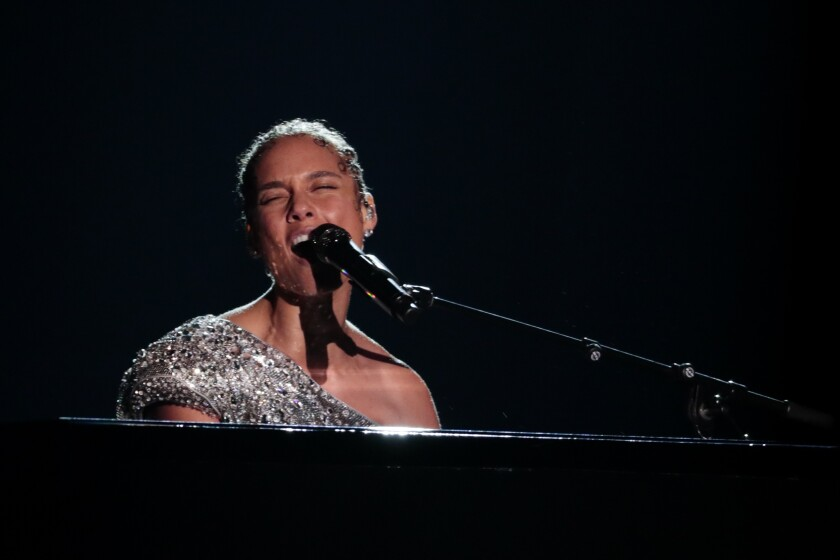 Host Alicia Keys performs at the 62nd Grammy Awards