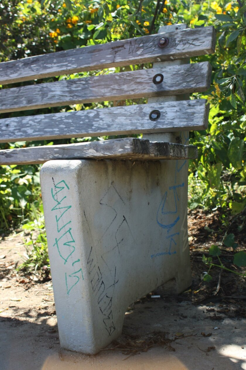 The underside of this memorial bench was tagged more than once.