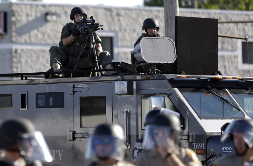 Scenes like this from Ferguson, Mo., last year sparked a national debate over militarized police. A bill in Sacramento would take the decision over whether to seek surplus federal military weapons away from police departments and place it in the hands of local elected officials in California.