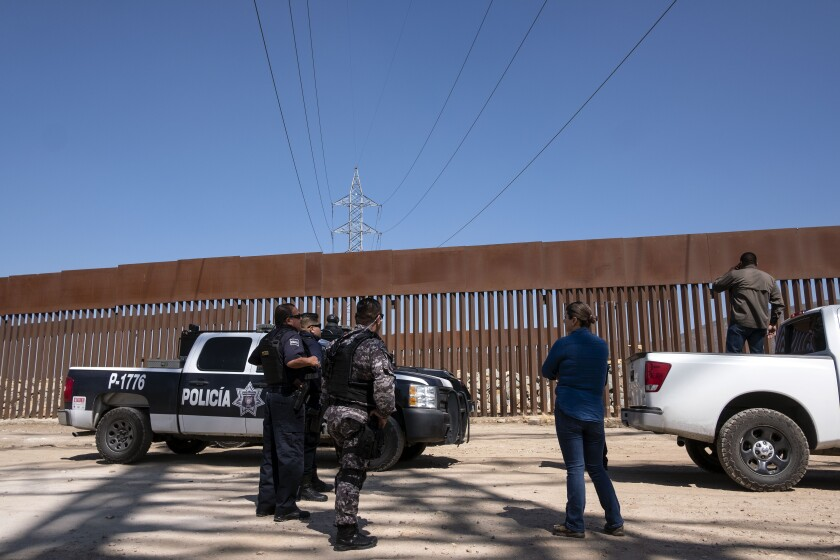 Mexican security forces patrol the U.S.-Mexico border fence in Tijuana in preparation for President Donald Trump's visit to the border wall in Otay Mesa.