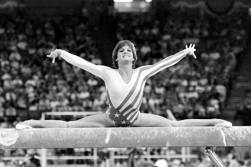 FILE - In this Aug. 3, 1984, file photo, Mary Lou Retton, of the United States, performs on the balance beam during the women's gymnastics individual all-around finals at the Summer Olympic Games in Los Angeles. (AP Photo/Suzanne Vlamis, File)