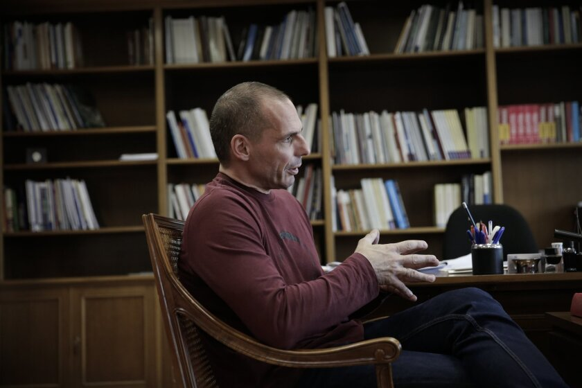 Greece's Finance Minister Yanis Varoufakis speaks during an interview with the Associated Press at his office, in central Athens, on Saturday, Feb. 28, 2015. Varoufakis said that Greece intends to start discussions with its European partners and creditors on debt rescheduling in order to make the country's massive debt sustainable. (AP Photo/Petros Giannakouris)