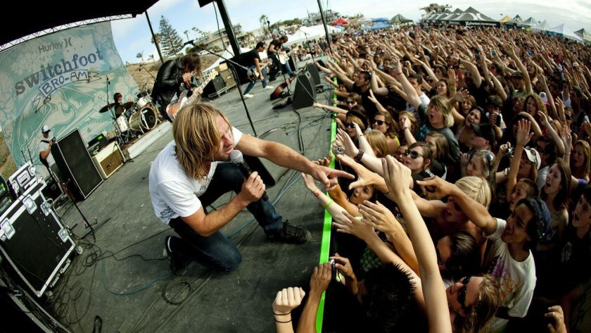 Jon Foreman (front) and Switchfoot are shown performing at their annual Bro-Am concert and surf contest at Moonlight Beach in Encinitas. This year's Bro-Am is on June 30.