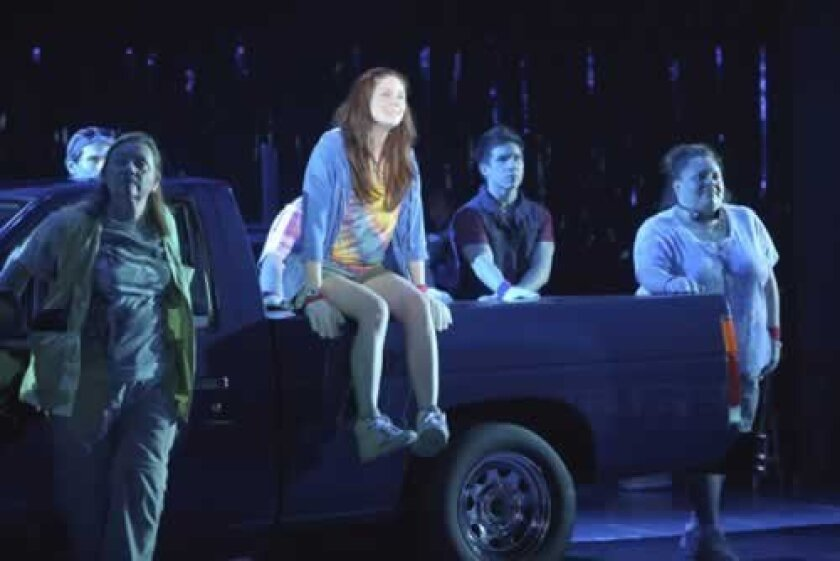 Kelli (Allison Case) sings why she needs to win a truck in 'Hands on a Hardbody,' directed by Neil Pepe in the Playhouse's Mandell Weiss Theatre. Kevin Berne