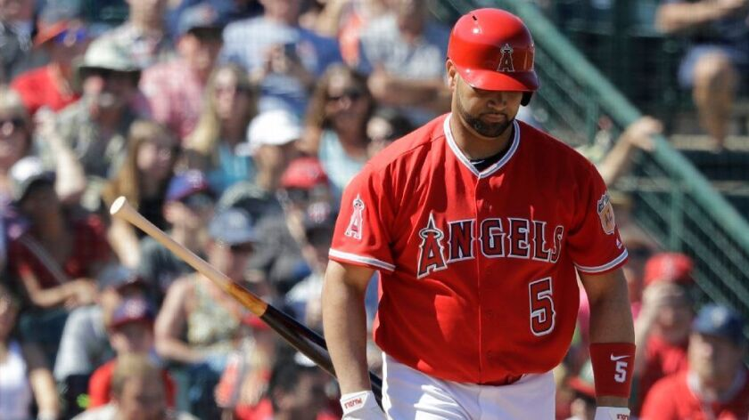 Albert Pujols makes his spring debut as a designated hitter in the Angels' 4-2 loss to the Padres