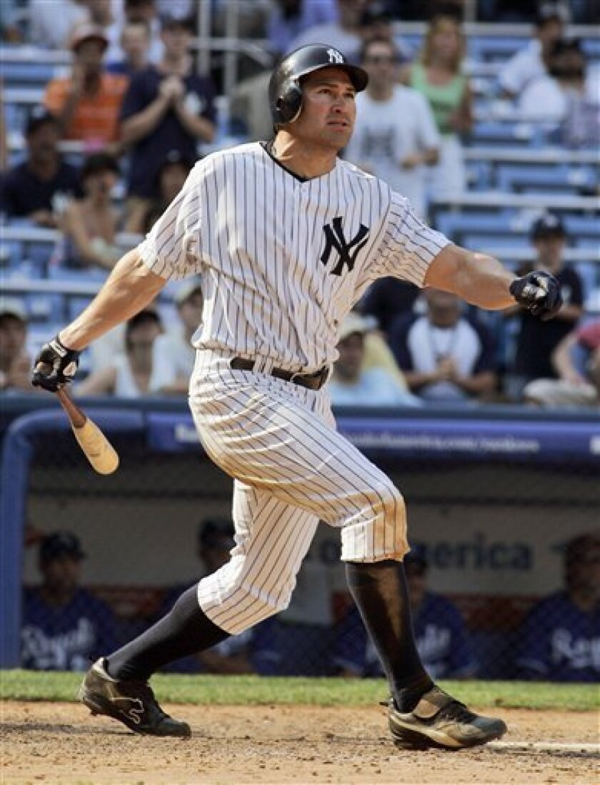 New York Yankees' Johnny Damon watches his game-winning single against the Kansas City Royals during the ninth inning of a baseball game at Yankee Stadium in New York, Saturday, June 7, 2008. Damon was 6-for-6 as the Yankees defeated the Royals 12-11. (AP Photo/Ed Betz)