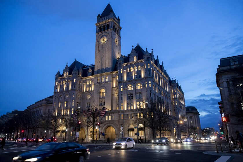 FILE - In this Jan. 23, 2019, file photo, the Trump International Hotel near sunset in Washington. Trump has his eye on hosting an election night party at his own hotel in the nation's capital. (AP Photo/Alex Brandon, File)