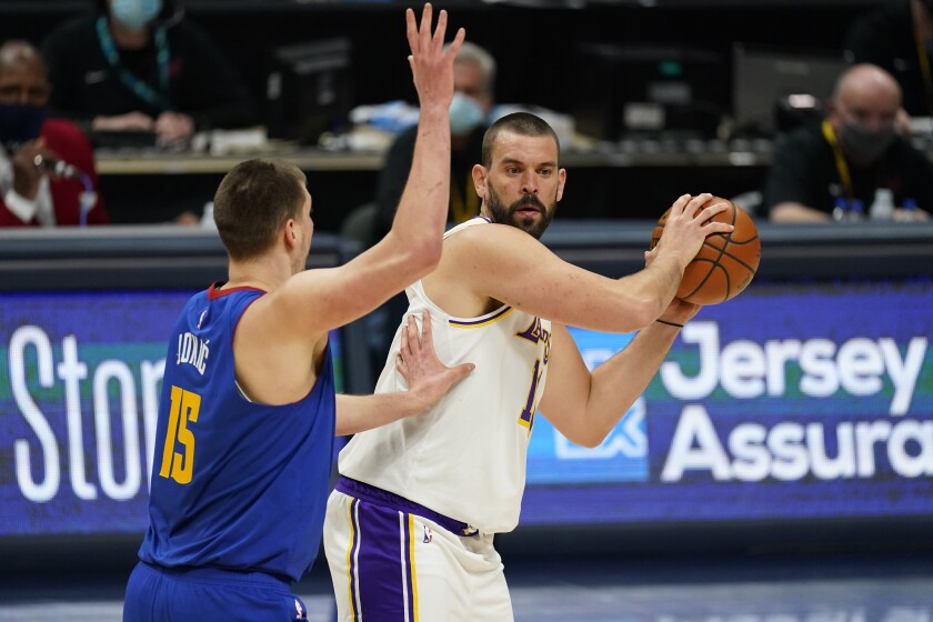 Lakers center Marc Gasol looks to pass as Denver Nuggets center Nikola Jokic defends.