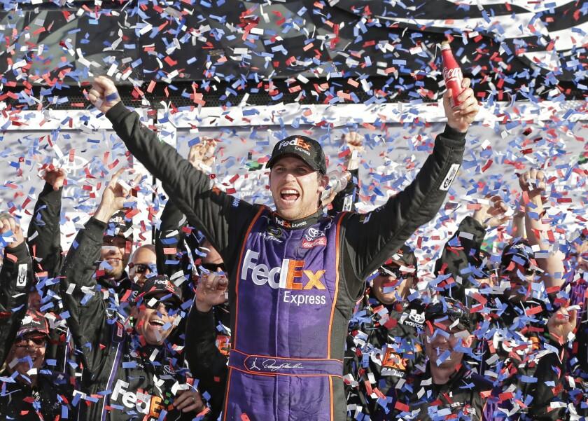 Denny Hamlin celebrates in Victory Lane.