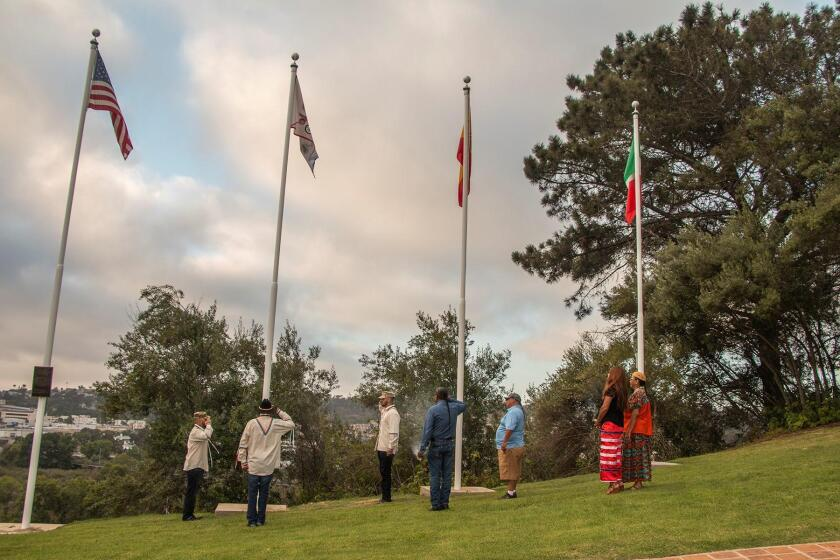 Four flags — American, Kumeyaay, Spanish and Mexican — now fly together at Presidio Park in San Diego. The July 16, 2019 event featured the dedication and addition of a Kumeyaay flag to the site.