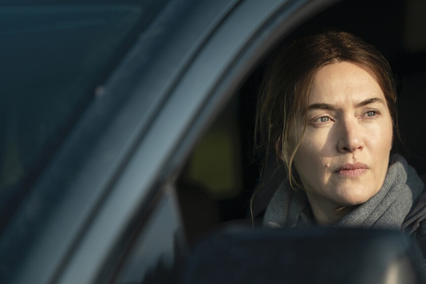 """Kate Winslet in looks out from her car in """"Mare of Easttown."""""""