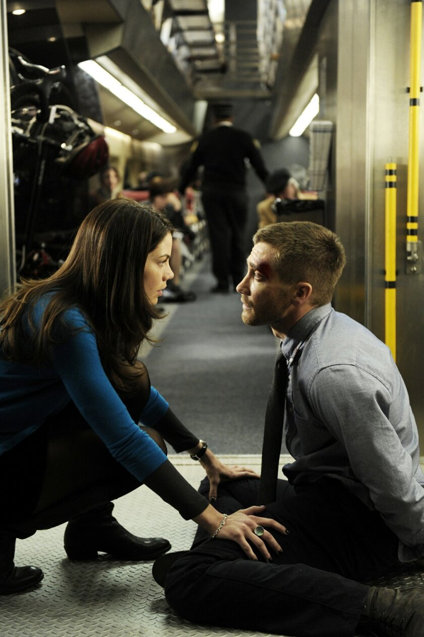 "Jake Gyllenhaal and Michelle Monaghan star in ""Source Code."" Jonathan Wenk • Summit Entertainment"