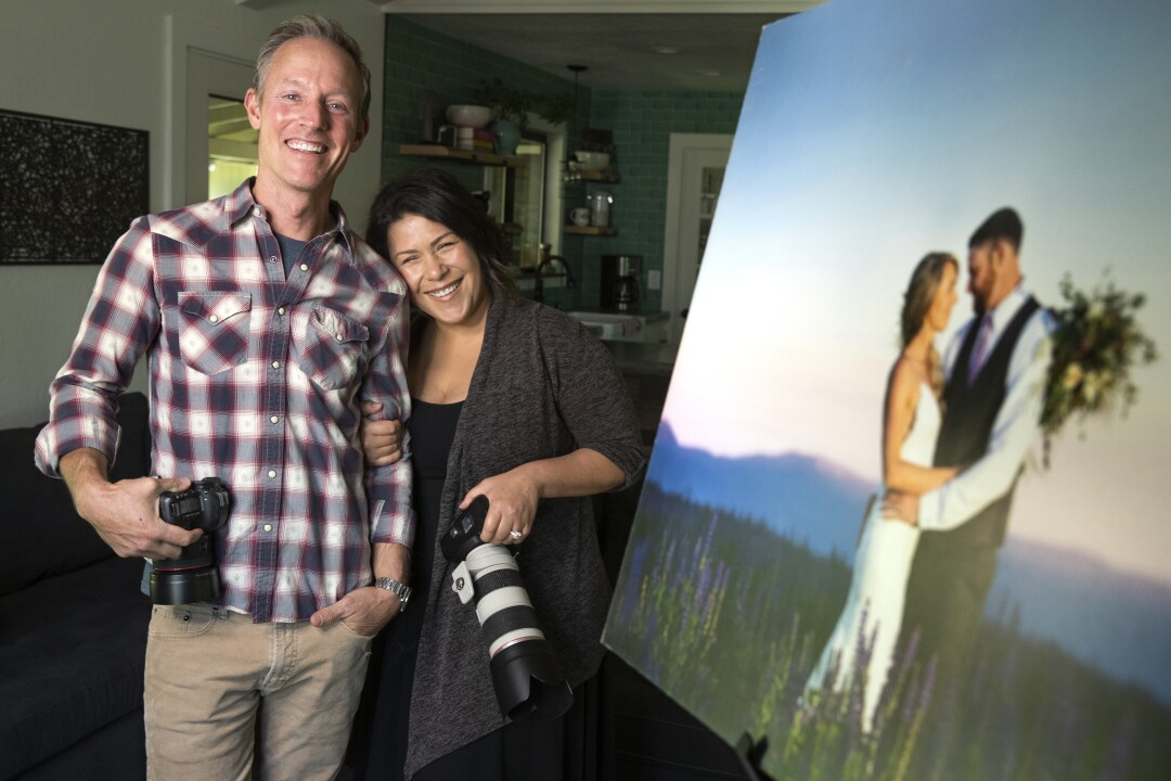 Wedding photographers Andrew Mishler and his wife Melanie, at their home in Penn Valley
