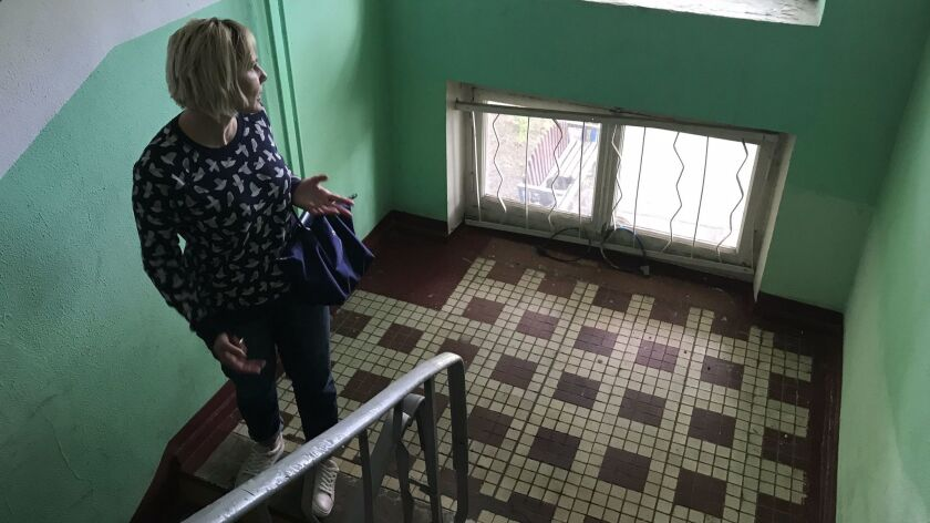 Olga Roslova, in her Soviet-era apartment building in Moscow, has collected signatures on petitions