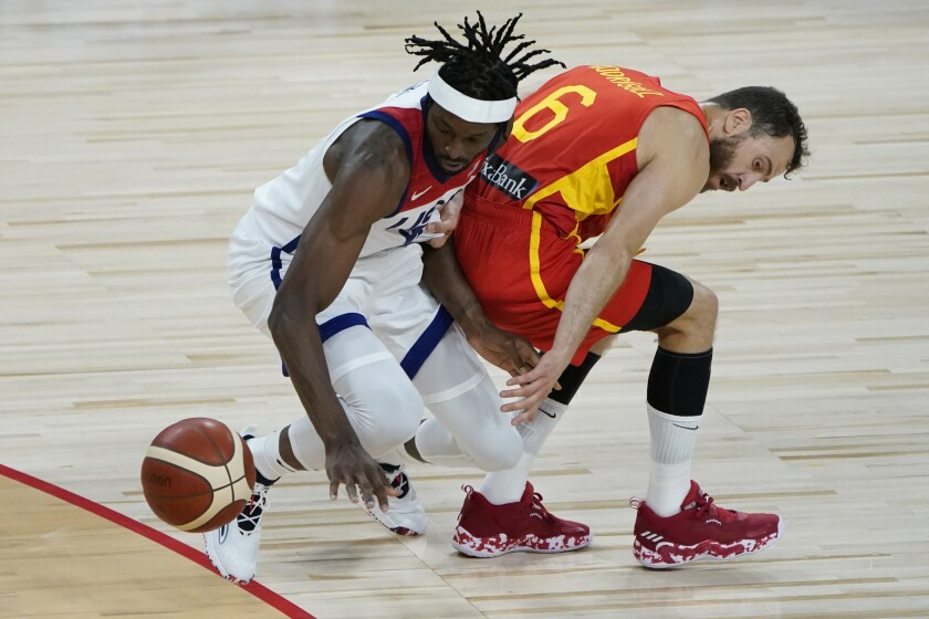 United States' Jerami Grant, left, and Spain's Sergio Rodriguez (6) battle for the ball during the second half of an exhibition basketball game in preparation for the Olympics, Sunday, July 18, 2021, in Las Vegas. (AP Photo/John Locher)