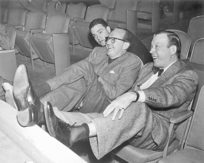 Berle Adams, left, watches a rehearsal of Jack Benny's show with Benny, center, and Fred Allen. At MCA, Adams packaged new TV shows and negotiated with networks.