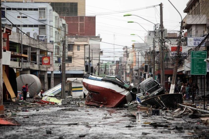 A boat lies marooned on a street in Talcahuano, Chile, Monday, March 1, 2010. An 8.8-magnitude earthquake struck central Chile early Saturday triggering a tsunami that hit coastal communities.