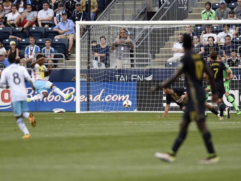 Columbus Crew's Ola Kamara, left, takes a shot and scores a goal on Philadelphia Union goalkeeper Matt Jones during the first half of an MLS soccer match on Wednesday, June 1, 2016, in Chester, Pa. (AP Photo/Michael Perez)