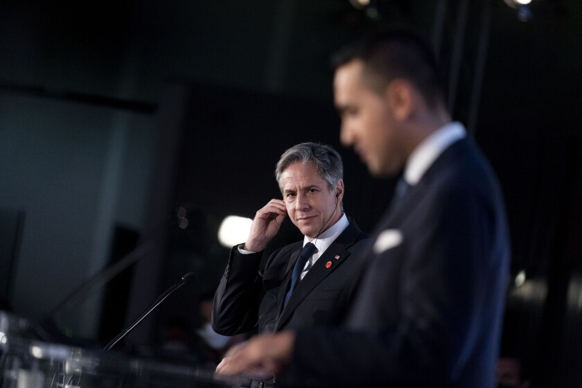 Secretary of State Antony J. Blinken listens as Italy's Foreign Minister Luigi Di Maio speaks during a news conference.