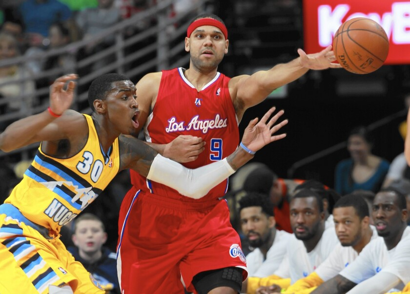 Jared Dudley, passing the ball under pressure from Nuggets forward Quincy Miller in 2014, will be returning to L.A. to play for the Lakers.