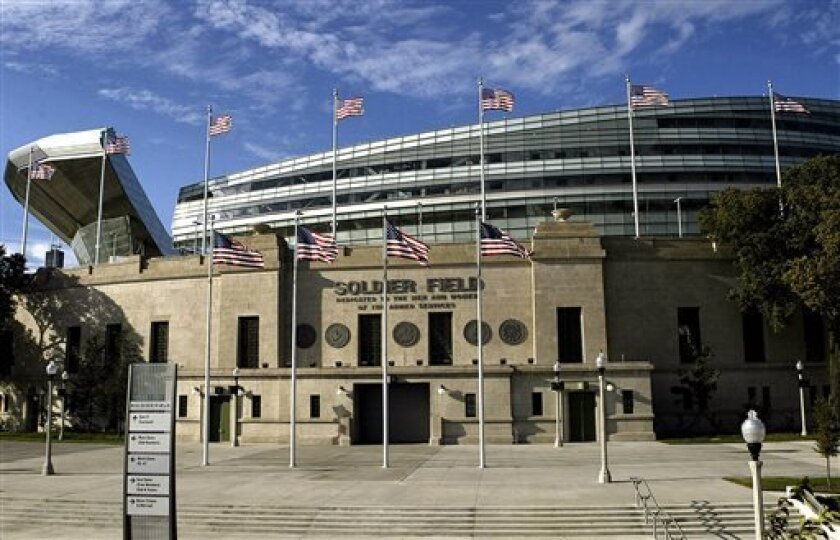 FILE - In this Sept. 24, 2004, file photo, an entrance to Soldier Field in Chicago, home of the NFL's Chicago Bears, is shown. The stadium first opened in 1924. The glassy, spaceship-like shell around the outside of the stadium was finished in 2003. (Nam Y. Huh, File)