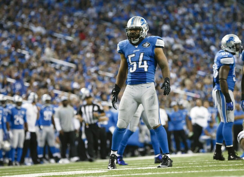FILE - In this Sunday, Oct. 19, 2014, file photo, Detroit Lions outside linebacker DeAndre Levy (54) celebrates a defensive play against the New Orleans Saints during an NFL football game at Ford Field in Detroit. (AP Photo/Rick Osentoski, File)