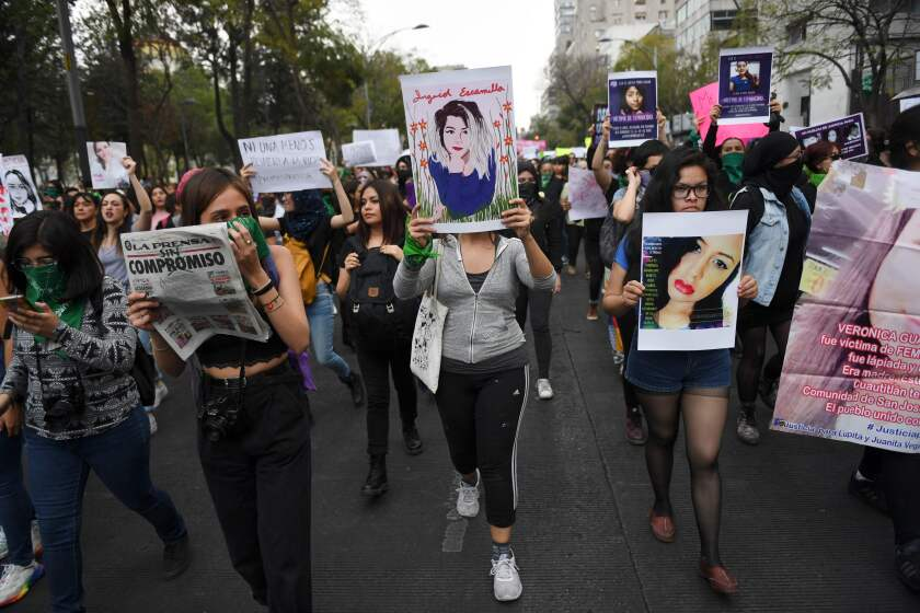 Women march Feb. 14 in Mexico City during a protest against gender-based violence.