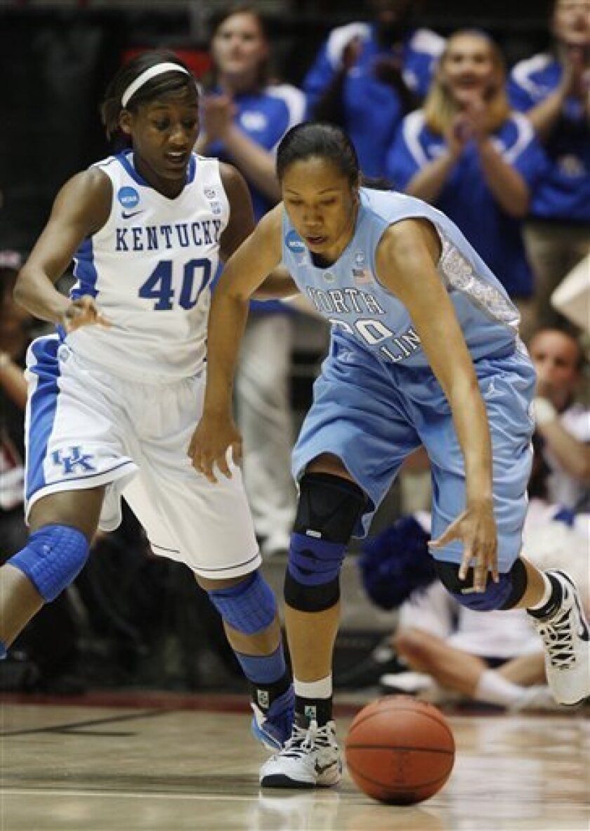 North Carolina's Chay Shegog, right, battles Kentucky's Brittany Henderson (40) for a loose ball during the first half of a second-round NCAA women's college basketball game, Monday, March 21, 2011, in Albuquerque, N.M. (AP Photo/Ross D. Franklin)