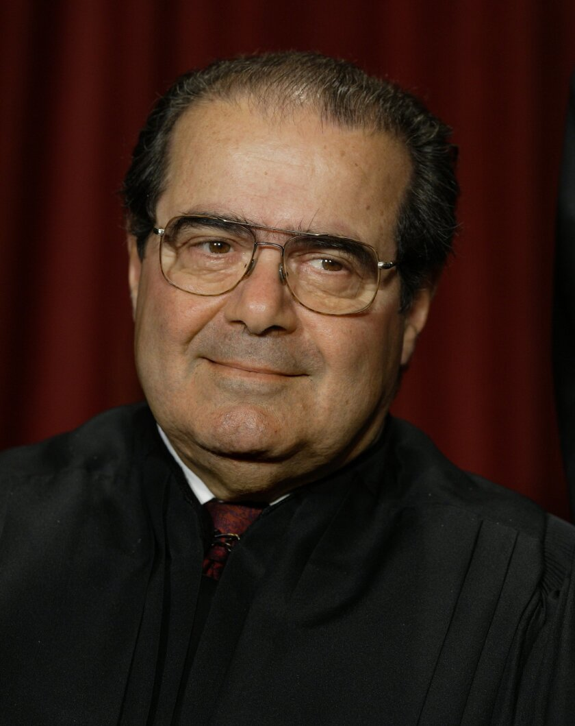 FILE - In this Monday, Oct. 31, 2005 file photo, Associate Justice Antonin Scalia joins the members of the Supreme Court for photos during a group portrait session, at the Supreme Court Building in Washington. On Saturday, Feb. 13, 2016, the U.S. Marshals Service confirmed that Scalia has died at t
