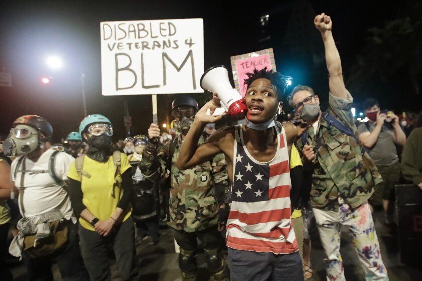 Demonstrators participate in a Black Lives Matter protest in Portland, Ore., on July 26.