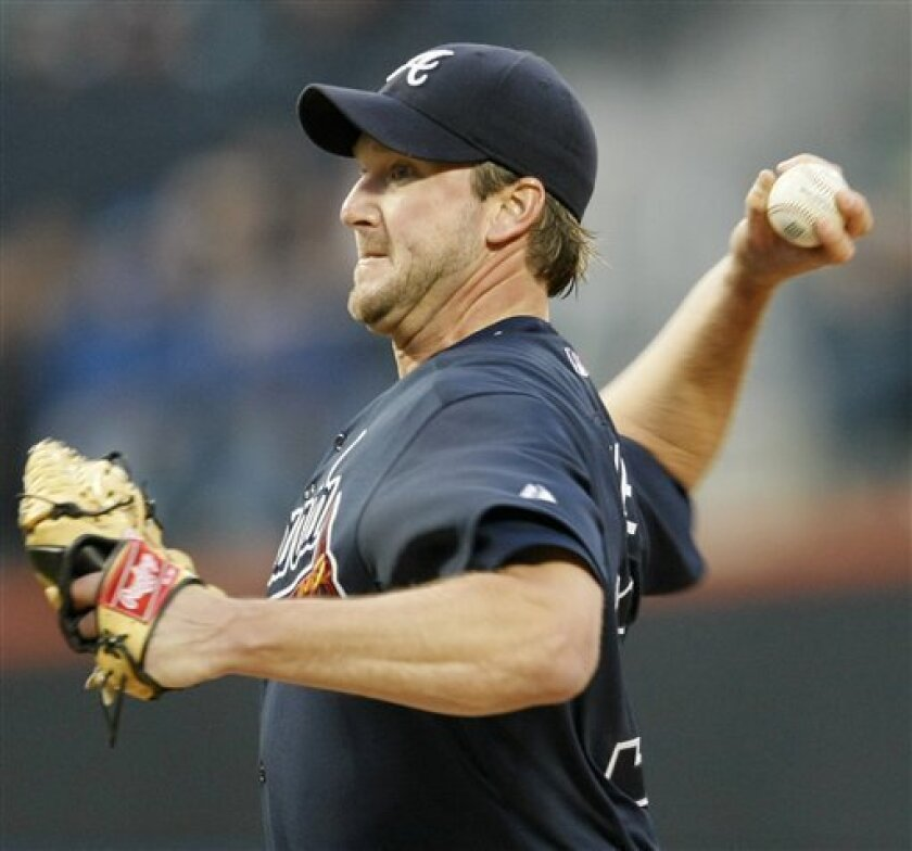 Atlanta Braves Derek Lowe delivers a pitch against the New York Mets in the first inning of a baseball game at Citi Field in New York, Monday, May 11, 2009. (AP Photo/Kathy Willens)
