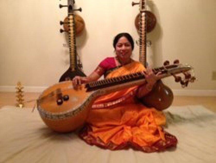 Smt. Anuradha Sundar playing the Veena, a melodic stringed instrument