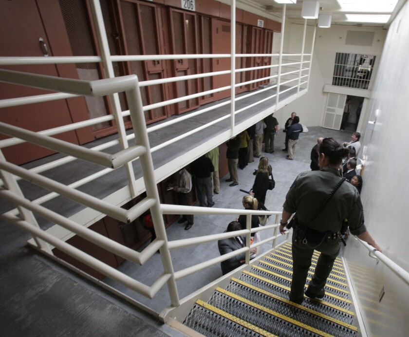 Reporters inspect one of the two-tiered cell pods in the Secure Housing Unit at the Pelican Bay State Prison near Crescent City, Calif. in 2011.