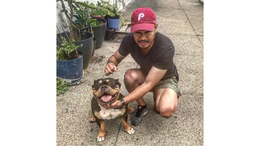 Kim Nak Chhoeun with Sashimi, a family dog. Chhoeun, now 42, came to the U.S. as a refugee when he w