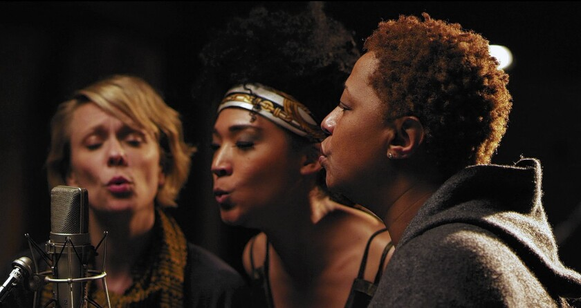 """Jo Lawry, left, Judith Hill and Lisa Fischer sing """"Lean on Me"""" in """"20 Feet From Stardom."""""""