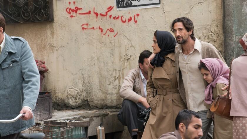 "Salma Hayek Pinault, Adrien Brody and Ariana Molkara in the movie ""Septembers of Shiraz."""