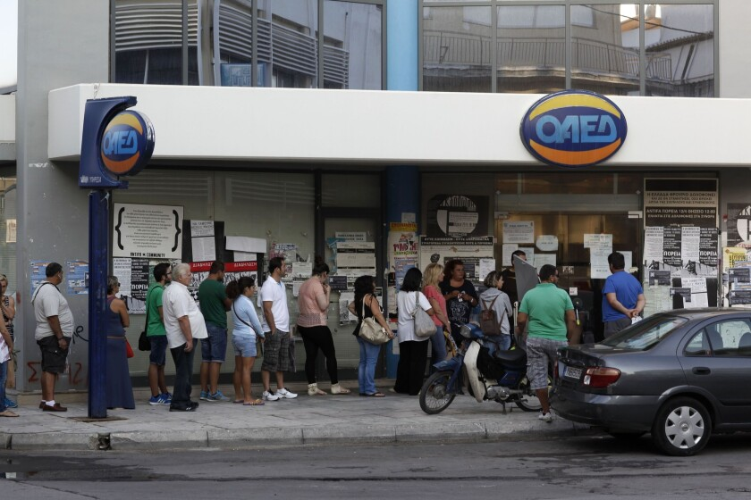 Growth in the 18-nation Eurozone will be just 0.8% this year, a new forecast says, down from an earlier projection of 1.2%. Above, job seekers line up at an employment center in Athens last week.