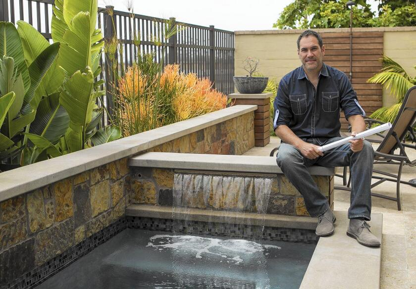 Mitch Kalamian, owner of Solena Landscape, shows off one of his latest project in Huntington Beach.