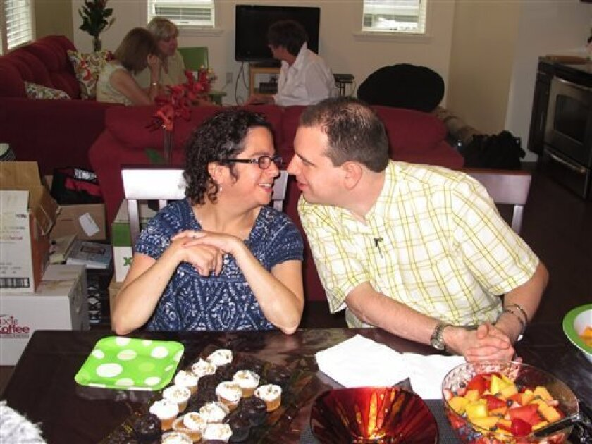 In this photo taken Monday, July 1, 2013, newlyweds Paul and Hava Forziano celebrate their first day in their new apartment at a group home in Riverhead, N.Y. The mentally disabled couple started a court fight after the group homes where they formerly lived denied them the opportunity to live together as a married couple. (AP Photo/Frank Eltman)