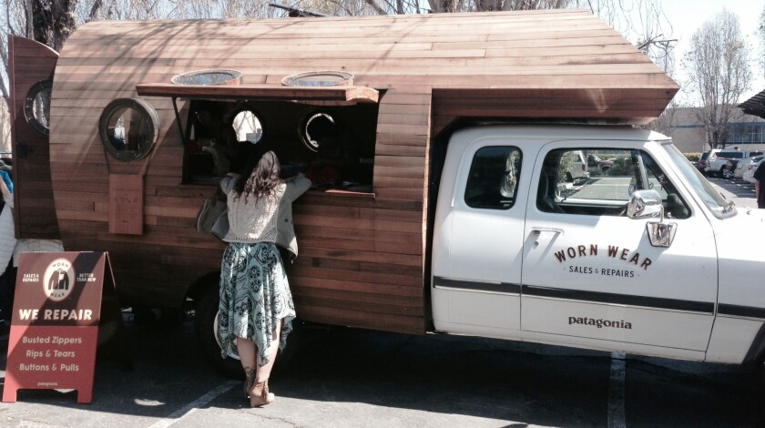 A converted biodiesel truck outfitted with industrial sewing machines sits in the parking lot of Patagonia's Ventura headquarters. On Saturday it will kick off a cross-country mobile repair tour in San Franciso.