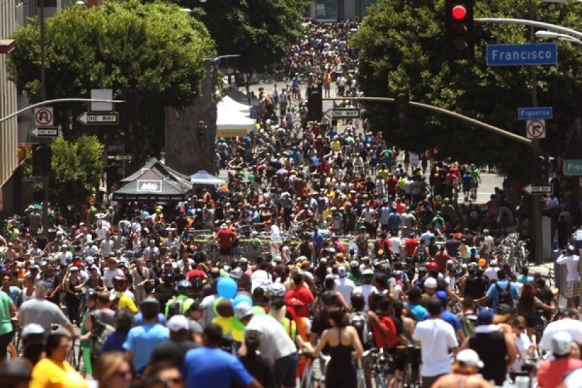 Cyclists crowd an area called the disembark and walk zone on Wilshire Boulevard at Figueroa Boulevard during CicLAvia in June.
