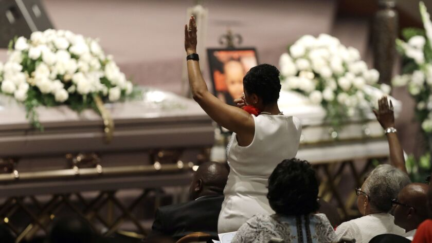 A member of the Coleman family stands during a musical selection at the funeral in Indianapolis on Saturday for five members of the family killed in a duck boat accident in Missouri.