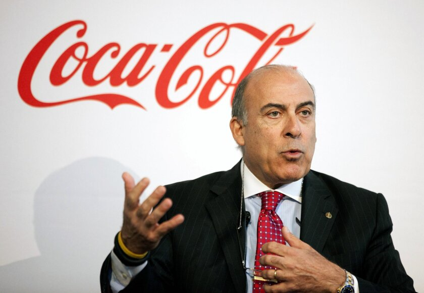 FILE - In this May 8, 2013 file photo, Coca-Cola CEO Muhtar Kent speaks during a news conference in Atlanta. Coca-Cola is revising its pay plan for executives after shareholders including Warren Buffett expressed disapproval and called it excessive. (AP Photo/David Goldman, File)