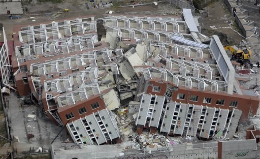 FILE - In this March 4, 2010 file photo, a collapsed building lays in ruins after an earthquake in Concepcion, Chile.  Wednesday, Feb. 27, 2013 marks the three year anniversary of the 8.8-magnitude earthquake that struck central Chile that killed over 500 people, destroyed over 200,000 homes and wa